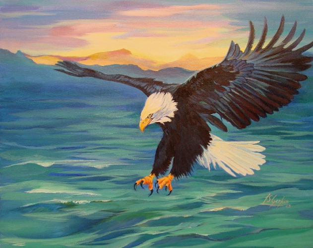 Bald Eagle flying over the ocean at sunset.